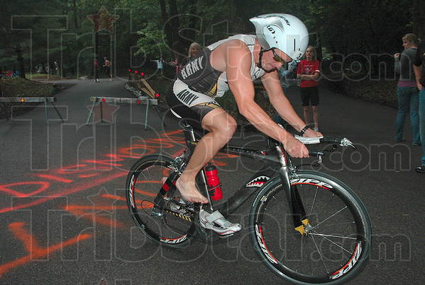 Tribune-Star/Joseph C. Garza<br /> Native competitor: Terre Haute native Nick Dason jumps on his bike to start the cycling portion of the Terre Haute Triathlon Saturday, May 22 at Hawthorn Park.