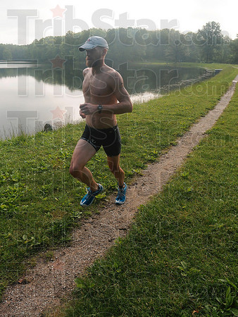 Tribune-Star/Joseph C. Garza<br /> Fast pace on the trail: Triathlete Ryan Shannahan races on the trail along the bank at Hawthorn Park during the Terre Haute Triathlon Saturday, May 22.