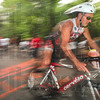 Tribune-Star/Joseph C. Garza<br /> From the water to the road: Mark Lund jumps on his bike to tackle the cycling portion of the Terre Haute Triathlon Saturday, May 22 at Hawthorn Park.