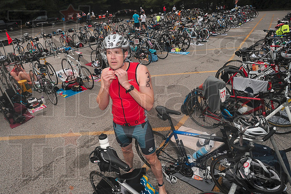 Tribune-Star/Joseph C. Garza<br /> Triathlete Jerry Snow fastens the strap on his helmet before darting off with his bike during the Terre Haute Triathlon Saturday, May 22 at Hawthorn Park.
