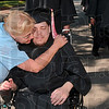 "Tribune-Star/Joseph C. Garza<br /> Like a son to her: Rose-Hulman housekeeping staff member Sue Garry couldn't help but break through the commencement procession to give senior Kyle Kopacz a hug and to wish him well before the engineering school's commencement Saturday. Garry has known Kopacz for six years through good times and bad. ""He's like a son to me,"" said Garry before she spotted Kopacz in line."