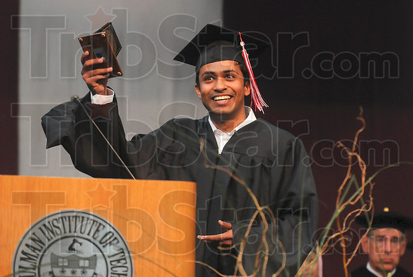 Tribune-Star/Joseph C. Garza<br /> Outstanding thesis: Avinash Ramesh of Chennai, India, displays his Outstanding Graduate Thesis Award Saturday during Rose-Hulman's 2010 Commencement.
