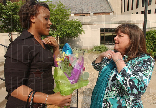 Catching up: Jasmine Worsham and Terri Moore chat before the ISU School of Nursing Pinning ceremony Friday evening. Worsham was Moores' preceptor at the Indianapolis VA hospital.