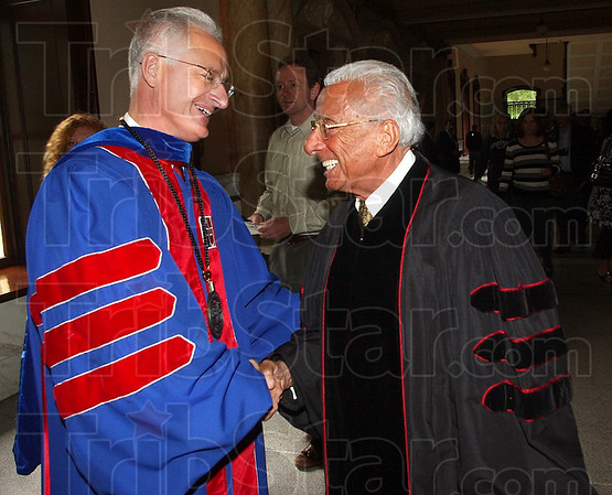 Welcome back: Saint Mary-of-the-Woods President David Behrs greets Rabbi Bernard Cohen just before Commencement ceremonies Saturday afternoon.