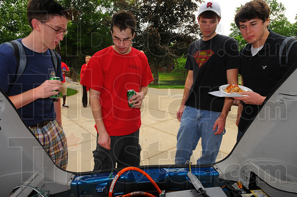 Show and tell: MIchael Bell, in red shirt, talks with fellow Rose-Hulman students Ryan Easterling, Andrew Jordan and Jordan Gameon about the Eco car project he is involved in.