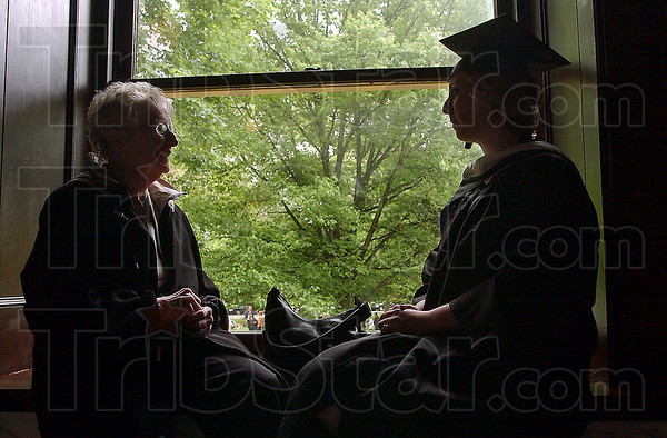 Time to catch up: Carolyn Bradshaw chats with her granddaughter Elizabeth Coley before commencement ceremonies at St. Mary-of-the-Woods Saturday. Coley, who earned a degree in K-6 Education, credits her grandmother, an educator, with inspiring her into her chosen field.