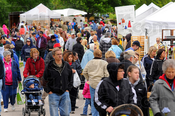 Big draw: Chilly, windy weather didn't keep the crowds away from the Wabash Valley Herb Societey's Spring Thyme Plant and Herb Faire held in Fairbanks Park Saturday.