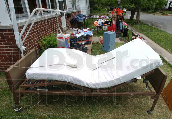 Stories to tell: A hospital bed, no longer needed, sits for sale in Erica Jacksons' yard sale last weekend.