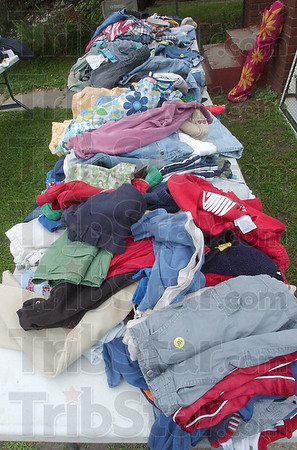 Cheap shorts: A pair of shorts, priced at just 10 cents, rests with other clothing items on a table at a yard sale on Terre Haute's southside.