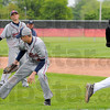 No handle: Terre Haute North pitcher Jordan Watson looks back to the ball wahile Northview batsman Kody Girton makes it safely to first base. Watching is Patriot Tony Roselli.