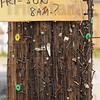 Message board: A utility pole at 13th street and 8th Avenue bears the marks of years' worth of yard sale advertising.