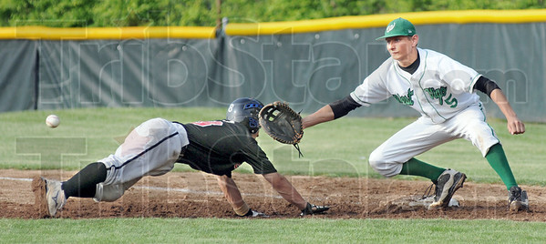 Pick-off: West Vigo's first baseman #5, Ryan Crowther reaches for an incoming throw fromt he pitcher during a pick-off attempt of Edgewood base runner #8, Braxton Raventos. The runner was safe on the play.
