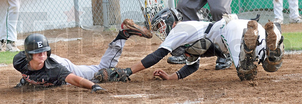Gotcha: West Vigo catcher Brody McCalister pouts the tag on Edgewood's #18, Tyler Cross as he attempts to score during game action Wednesday night.