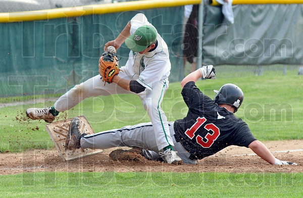 Gotcha: West Vigo's #7, third baseman Nolan Flinn tries to get out of the way of Edgewood's #13, Jade Jones after tagging him out during game action Wednesday evening.