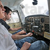 Flight team: Indiana State Flight Team members Blake McCall and Christian Reid sit in the cockpit of an aircraft that will be flown during the NCAA meet.