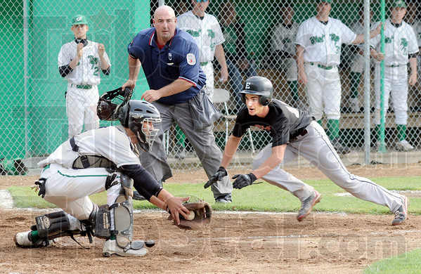 Out: Home plate umpire Rusty Goodwin watches as West Vigo catcher Brody McCalister is about to put the tag on Edgewood's #18, Tyler Cross as he attempts to score during game action Wednesday night.