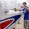 Check it: Indiana State University Flight Team member Andrew Carboneau checks the oil in one of the aircraft that will be used by the team during the NCAA meet.