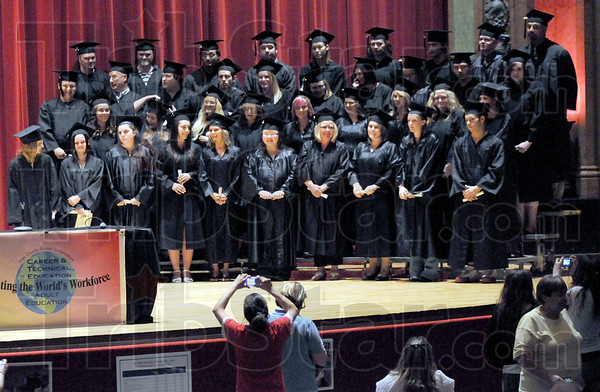 Graduates: GED graduates of 2010 pose for photographs after receiving their diplomas Wednesday evening.