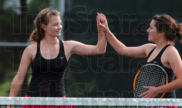 Tribune-Star/Joseph C. Garza<br /> Game, set, match: Terre Haute South No. 1 doubles teammates Mallory Metheny and Emma Bilyeu celebrate their sectional win over Terre Haute North's Mary Kate Etling and Morgan Mills Wednesday at South.