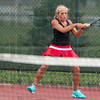 Tribune-Star/Joseph C. Garza<br /> Backhand to backhand: Terre Haute South's Taylor Bullock chases a down the ball with a backhand to opponent Anna Potter of Terre Haute North during their No. 2 singles sectional match Wednesday at South.
