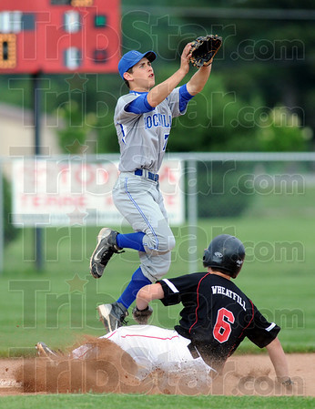 In there: South's #6, Ricky Wheatfill slides safely into second base as Rockville's #7, Tyler Bradburn leaps into the air to catch a high throw during game action Wednesday evening.