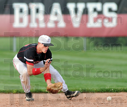 Brave stopper: South shortstop Jacob Hayes stops a hard-hit ground ball during game action against Rockville Wednesday evening.