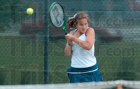 Tribune-Star/Joseph C. Garza<br /> Concentrating on ball placement: Terre Haute North's Anna Potter returns a backhand to South opponent Taylor Bullock during their No. 2 singles sectional match Wednesday at South.