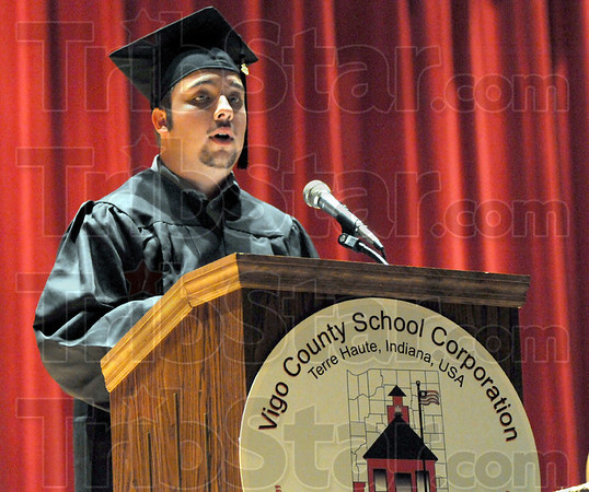 Speaker: Graduate Christopher Nees speaks with the GED class during Wednesday's graduation ceremony at Woodrow Wilson.