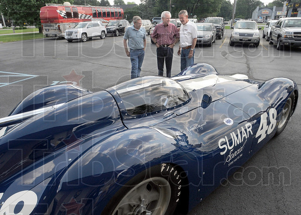 Remember when: Former drivers Ron Dawes, Jim McGee and Bobby Unser talk about Action Track days-gone-by Wednesday afternoon at the First Financial Conference Center. The restored Sumar Special sits at the entrance.