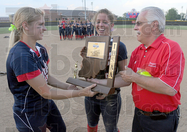 Champs: Terre Haute North team captains Bethany Sullivan and Danielle Ketner accept the Sectional championship trophy from Plainfield High School Athletic Director Dana Greene after the Patriots 2-0 win over rival Terre Haute South.