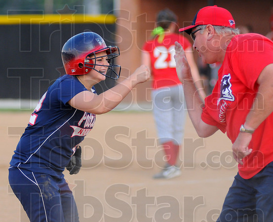 Fun times: Patriot Amber Maffioli celebrates with coach Jack Kirchner after her two run triple that ended up being the game winning hit.
