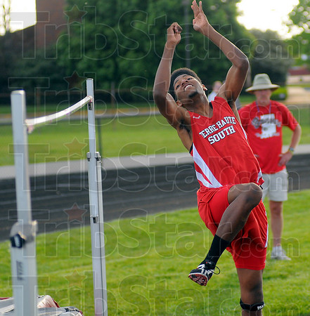 Up and over: Brave high jumper Jermaine Smith eyes the bar out of the corner of his eye as he competes Wednesday evening.