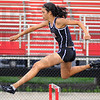 High on the lows: Tasia Brewer flies over the first hurdle in the 300 meter low hurdle race.