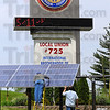 Setup: Setting up the new solar array at the International Brotherhood of Electrical Workers hall at State Road 46 and Hulman are Tom Szymanski, Brian Wood and Charlie Nettles(unseen). The array and one twice as big near the hall itself were purchased through a grant from the Indiana Office of Energy Development. This one will power the electronic sign board, feeding leftover energy back into the Duke Energy grid.