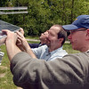 Setup: Setting up the new solar array at the IBEW hall at State Road 46 and Hulman are Charlie Nettles, Tom Szymanski and Brian Wood. The array and one twice as big near the hall itself were purchased through a grant from the Indiana Office of Energy Development. This one will power the electronic sign board, feeding leftover energy back into the Duke Energy grid.