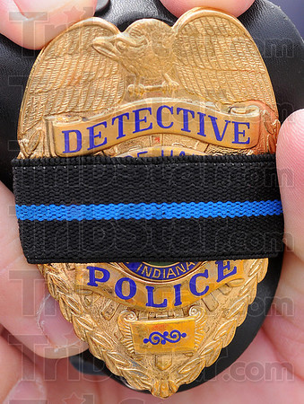 "Thin blue line: Several police officers carry a form of eh ""Thin Blue Line"" some on their badge like this or a sticker on their vehicle. It represents their role in seperating the evil from the good in society."