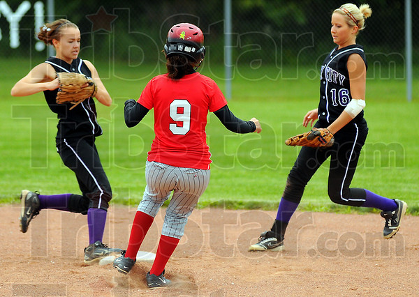 Force out: Eel Abby Red tags second base to force out Terre Haute South baserunner Dana Hedden. Watching is Allison Carroll(16).