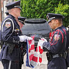 Proper respect: The Terre Haute police color guard folds the old, worn flag during the memorial ceremony Monday afternoon. Officers Dale Blunk and Josh PIrtle are closest to the camera.