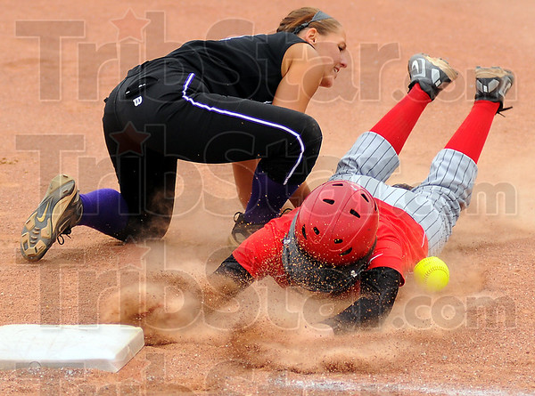 Back safe: Terre Haute South baserunner Marissa Stout gets back to first base safely as Clay City's Sloan Miller can't handle the throw.