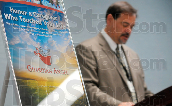 Tribune-Star/Joseph C. Garza<br /> For the angels among us: Union Hospital Foundation Executive Director Jim Bertoli talk about the hospital's new Guardian Angel program that allows patients to recognize physicians, staff members or volunteers during a presentation Monday at the hospital.