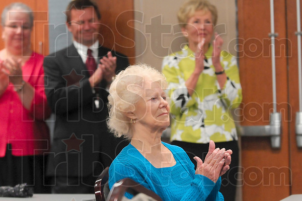 Tribune-Star/Joseph C. Garza<br /> Worthy of applause: Former Union Hospital patient, Barbara Thomas, applauds with others for the physicians, nurses, staff members and volunteers that were recognized during the announcement of the Guardian Angel program Monday at Union Hospital.
