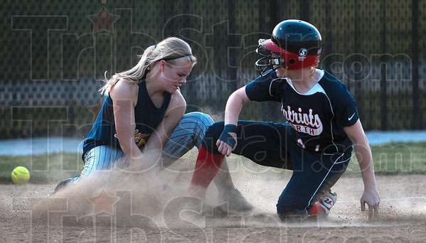 An opportunity to score: Terre Haute North's Alisha Ludwig slides into third base as Mooresville's Tori Wilson looses control of the ball in the sixth inning of the Patriots' sectional win over the Pioneers Monday at Plainfield High School.