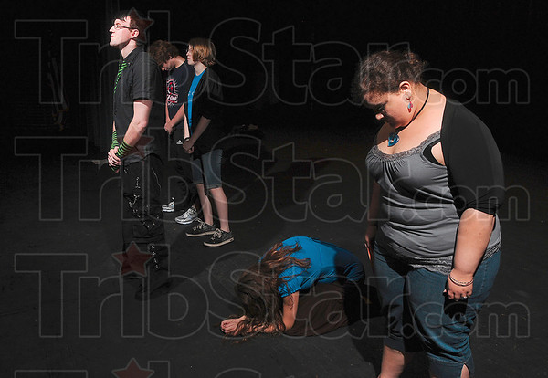 Tribune-Star/Joseph C. Garza<br /> Then they came for me...: Terre Haute North student Stephan McLaughlin recites the words attributed to Pastor Martin Niemoller during rehearsal for the play, No Evil, Monday at Terre Haute North.