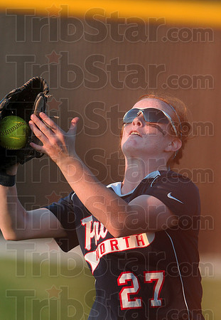 Out of the sun, no problem: Terre Haute North's Alisha Ludwig catches a Mooresville pop fly as she faces the setting sun Monday at Plainfield High School.