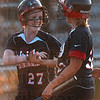 Game winner: Terre Haute North's Alisha Ludwig celebrates her game-winning run with teammate Hailee Travioli during the Patriots' 1-0 sectional win over Mooresville Monday at Plainfield High School.