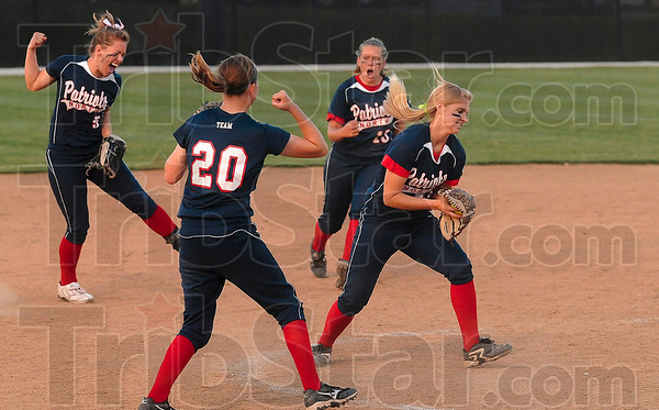 That seals the deal: Terre Haute North's Danielle Ketner, Marlee Yeager and Hailee  Travioli celebrate after teammate Bethany Sullivan, far right, caught the final out to win the Patriots' sectional game againt Mooresviile.
