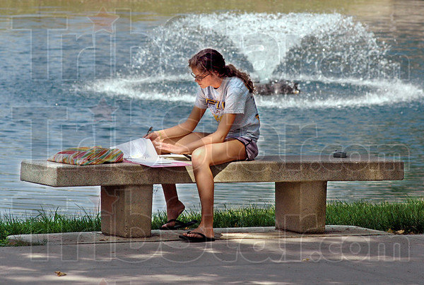 Sunny studies: Rose-Hulman freshman Rebecca Fleming of Arlington, Virginia studies at an outdoor location on campus Monday morning. She's a mechanical engineering student.