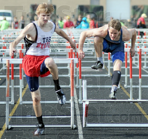 One two: South's Jeremy Patterson (L) clears the final hurdle and goes on to win the event during Tuesday's North/South track meet. North's John Brainard hits the final hurdle and loses by a small margin.
