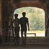 Tribune-Star/Joseph C. Garza<br /> The other covered Indiana: Purdue University students and Cover Indiana Bicycle Tour participants Chris Strupp and Alex Ray are silhouetted as they walk across the Bridgeton Bridge during a break in the riding Tuesday.