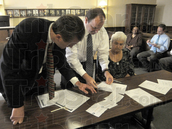And the winner is: Democrat party chairman Joe Etling (L) , John Wright and Deborah Kirk Peters look at the final vote totals after the first ballot Tuesday night. Pat Ralston received 8 of the 11 votes to win.